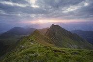 Austria, Tyrol, Inn Valley, Kellerjoch at sunrise, hiker on mountaintop - CVF00894