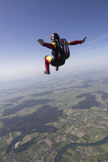 Female skydiver free falling over Grenchen, Berne, Switzerland - CUF34818