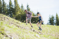 Mid adult couple walking in Tegernsee, Bavaria, Germany - CUF35397