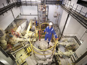 Portrait of engineer in seawater pumping station of power station, high angle view - CUF35418