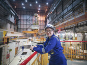 Portrait of female engineer in reactor hall in nuclear power station - CUF35517