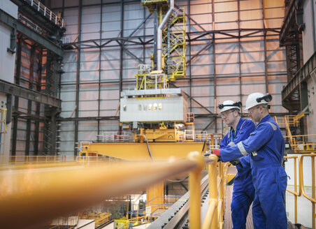 Engineers inspecting reactor hall in nuclear power station - CUF35523
