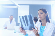 Female doctor looking at x-ray - CUF35685