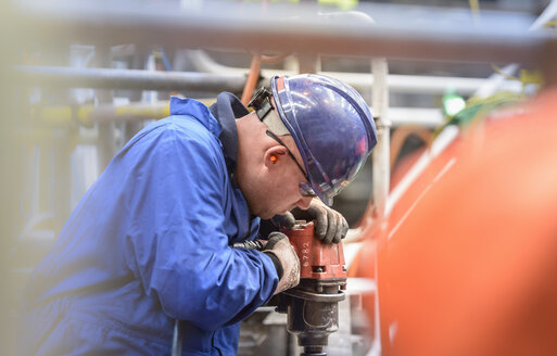 Engineer drilling during power station outage - CUF36050