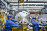 Engineers inspecting turbine during power station outage - CUF36077
