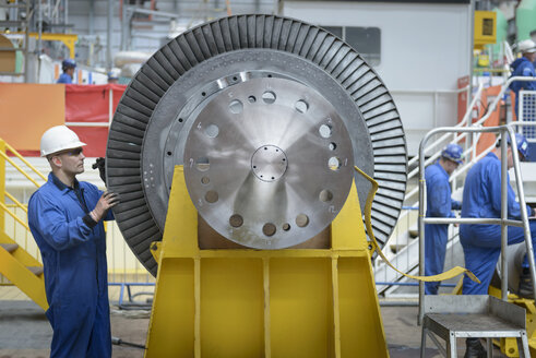 Engineers inspecting turbine during power station outage - CUF36080