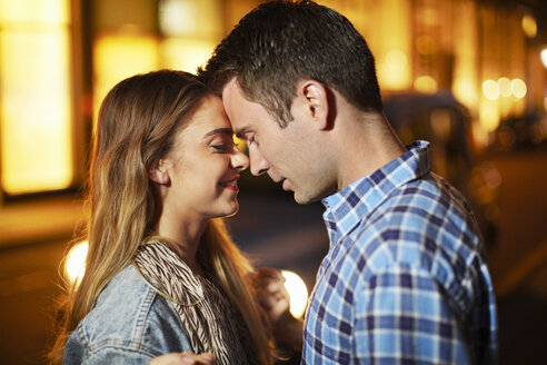 Romantic couple face to face city street at night - CUF36317