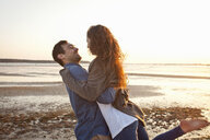 Couple having fun on beach - CUF36365