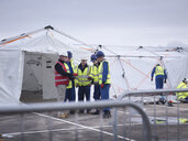 Emergency Response Team workers training in control centre tent - CUF36563