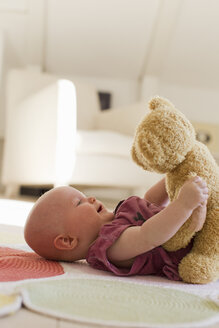 Baby girl playing with teddy bear - CUF36769