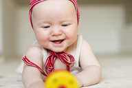 Portrait of baby girl smiling - CUF36778