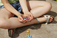 Cropped shot of girl with holding multi colored elastic bands - CUF36922