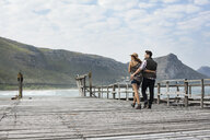 Young couple strolling along old pier, Cape Town, Western Cape, South Africa - CUF36925