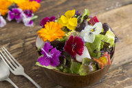 Bowl of salad with edible flowers - SKCF00522