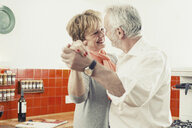 Couple dancing in kitchen - CUF37018