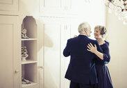 Couple dancing in bedroom - CUF37030