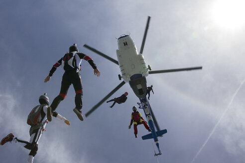 Low angle view of helicopter and six skydivers free falling, Siofok, Somogy, Hungary - CUF37063