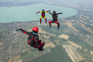 Three skydivers freeflying in formation, Siofok, Somogy, Hungary - CUF37066