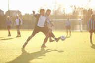 Football players fighting for ball - CUF37102
