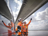 Bridge workers and support truck under suspension bridge. The Humber Bridge, UK was built in 1981 and at the time was the world's largest single-span suspension bridge - CUF37213