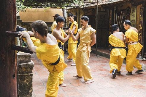 Vietnam, Hanoi, men exercising kung fu, european man learning kung fu - WPEF00523