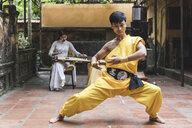 Vietnam, Hanoi, young man exercising Kung Fu - WPEF00526