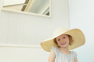 Portrait of girl with sunhat on in holiday apartment - CUF37648