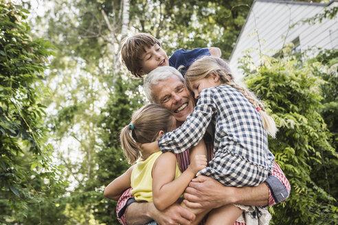 Grandfather holding three grandchildren - CUF37837