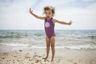 Portrait of jumping female toddler on beach at Falmouth, Massachusetts, USA - ISF14649