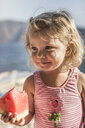 Little girl with a watermelon slice - ISF14816
