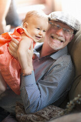 Grandfather holding granddaughter - ISF14819