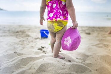 Baby playing on sandy beach - ISF14906