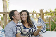 Couple enjoying drinks in resort bar, Providenciales, Turks and Caicos Islands, Caribbean - ISF15104