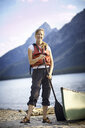 Portrait of female canoeist by lake, Grand Tetons, Wyoming, USA - ISF15224