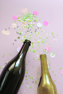 Stillife with champagne and wine bottle and confetti - HSTF00061