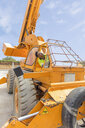 Construction worker operating crane - ZEF15746