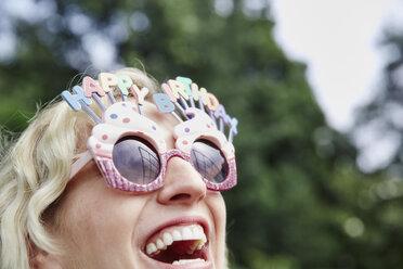 Happy woman wearing birthday eyeglasses - RHF02044