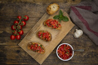 Bruschetta with tomato and basil on wooden board - LVF07177