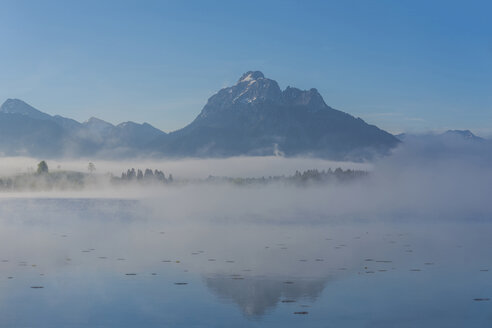 Germany, Bavaria, Allgaeu, Ammergau Alos, Mountains at Lake Hopfensee and fog - WGF01202