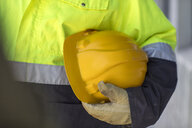 South Africa, Cape Town, Builder holding hard hat - ZEF15771