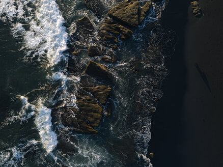 Indonesia, Bali, Indian Ocean, Aerial view of rocky coast and waves - KNTF01124
