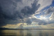 Germany, Bavaria, Chiemgau Alps, Chieming at Chiemsee, dark clouds over Lake Chiemsee - LBF01988