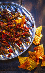 Chili con Carne with tortilla chips on aluminium grill tray - KSWF01929