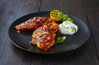 Grilled chicken breast fillet with sour cream on plate - KSWF01935
