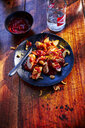Currywurst with barbecue sauce on plate - KSWF01938