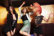 Four female friends dancing in nightclub - CUF38409