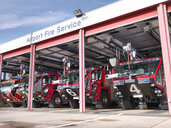 Fire engines in airport fire station - CUF38481