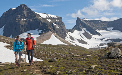 Hikers hiking at Dyrfjoll Mountain range, East Iceland, Iceland - CUF38589