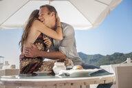 Young couple hugging at beach, Castiadas, Sardinia, Italy - ISF15583