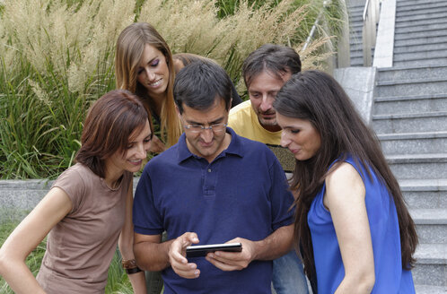 Group of friends looking at smartphone - CUF38659